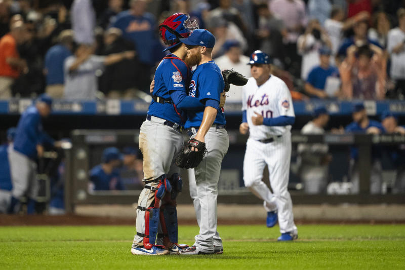 Chicago Cubs catcher Victor Caratini (7) hugs Chicago Cubs pitcher Craig Kimbrel (24) after the last out in the ninth inning against the New York Mets at Citi Field. (USA Today)