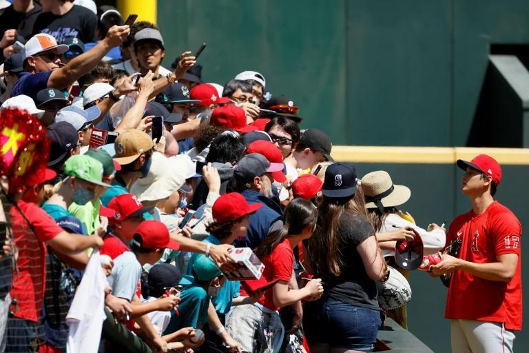 Shohei Ohtani has become hugely popular with fans, always taking time to sign autographs (AFP/Steph Chambers)