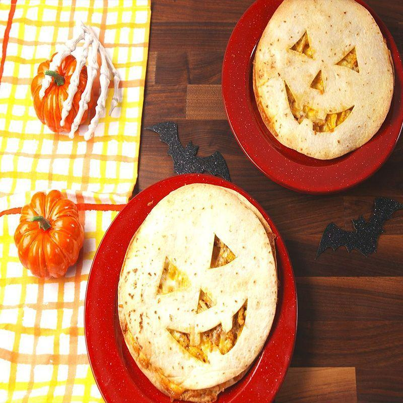 """<p>Slice these not-so-scary faces into triangles and serve on a platter with some scream-worthy dipping sauce.</p><p><em>Get the recipe at <a href=""""https://www.delish.com/cooking/recipe-ideas/recipes/a55712/jack-o-lantern-quesadillas-recipe/"""" rel=""""nofollow noopener"""" target=""""_blank"""" data-ylk=""""slk:Delish"""" class=""""link rapid-noclick-resp"""">Delish</a>. </em></p>"""
