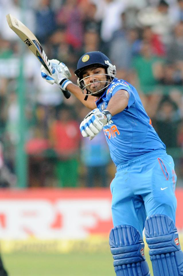 Indian player Rohit Sharma celebrate his century during the 7th ODI between India and Australia played at Chinnaswamy Stadium in Bangalore on Nov.2, 2013. (Photo: IANS)