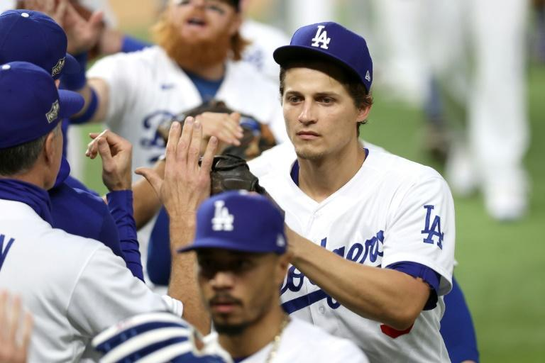 Corey Seager, right, of the Los Angeles Dodgers celebrates with teammates after their 3-1 win against the Atlanta Braves