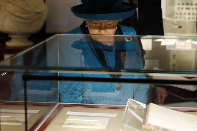 The Queen during a visit to the new headquarters of the Royal Philatelic Society in London