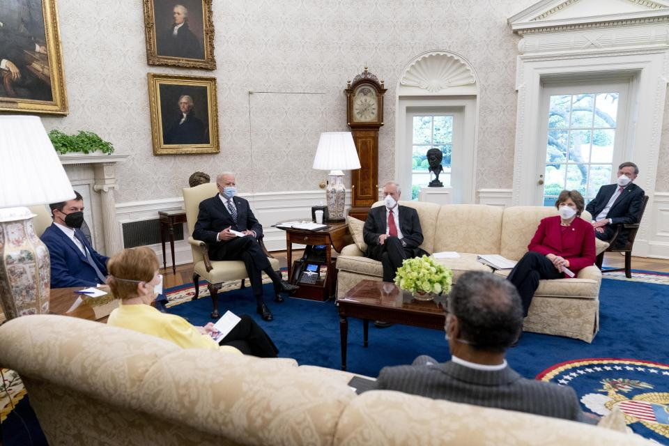 FILE - In this April 19, 2021, file photo, President Joe Biden meets with, from left, Transportation Secretary Pete Buttigieg, Rep. Kay Granger, R-Texas, Sen. Angus King, I-Maine, Rep. Emanuel Cleaver, D-Mo., Sen. Jeanne Shaheen, D-N.H., Sen. John Hickenlooper, D-Colo., and other members of congress to discuss his jobs plan in the Oval Office of the White House in Washington. The outreach to Congress is nothing new for presidents, but Biden is a veteran of Capitol Hill who knows how to tap the desire of even the most partisan legislators to legislate. (AP Photo/Andrew Harnik)