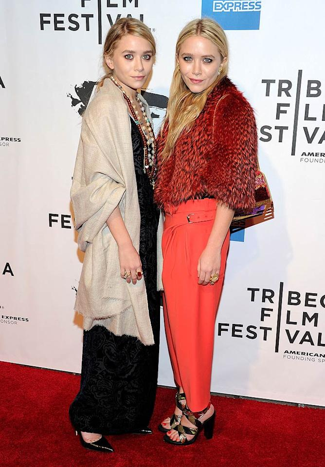 "The Olsen twins struck again upon arriving at the opening night premiere of ""The Union"" at the 2011 Tribeca Film Festival. Ashley decided to don a few too many necklaces and a curtain-like coat, while her sister, Mary-Kate, opted for a Muppet pelt and bright peach pants. Discuss. Jason Kempin/<a href=""http://www.gettyimages.com/"" target=""new"">GettyImages.com</a> - April 20, 2011"