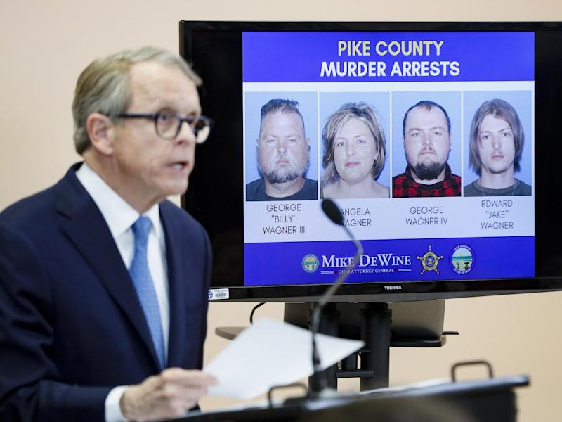 Ohio Attorney General Mike DeWine speaks alongside a display of those arrested during a news conference: AP Photo/John Minchillo