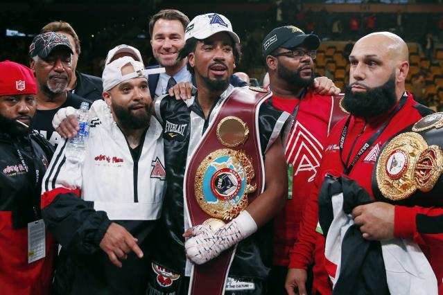 FILE - In this Oct. 21, 2018, file photo, Demetrius Andrade, center, stands with members of his team after defeating Walter Kautondokwa in a WBO middleweight championship boxing match in Boston. Andrade is just a few months from winning a middleweight title but perhaps still far away from fights with the divisions biggest names. Canelo Alvarez, Gennady Golovkin and Daniel Jacobs are the headliners at 160 pounds, and while perhaps one or more of them could someday be in Andrades future, it doesnt appear to be the near future. (AP Photo/Michael Dwyer, File)