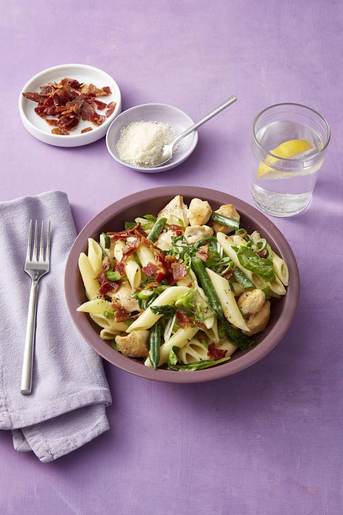 "<p>This heart-healthy, 25-minute dinner features green beans and spinach, but would taste equally delicious with asparagus, sugar snaps, or frozen corn.</p><p><strong><a href=""https://www.womansday.com/food-recipes/food-drinks/a19133143/chicken-green-bean-and-bacon-pasta-recipe/"" rel=""nofollow noopener"" target=""_blank"" data-ylk=""slk:Get the recipe."" class=""link rapid-noclick-resp"">Get the recipe.</a></strong><br></p>"