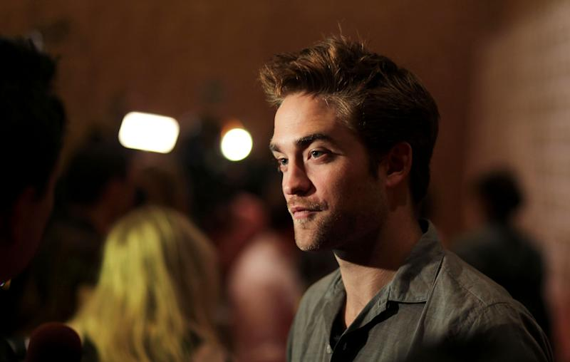 "Actor Robert Pattison arrives at the ""The Twilight Saga: Breaking Dawn - Part 2"" press line during Comic-Con, Thursday, July 12, 2012, in San Diego. (Photo by Matt Sayles/Invision/AP)"