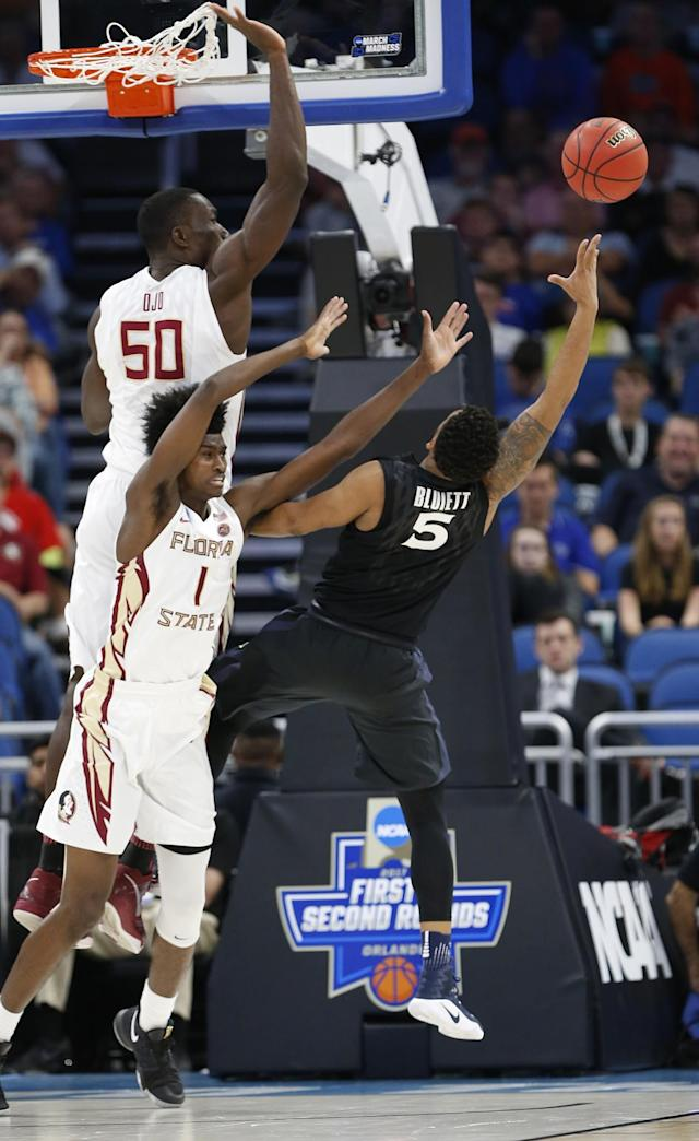 <p>Xavier's Trevon Bluiett (5) shoots as Florida State forward Jonathan Isaac (1) and center Michael Ojo (50) defend, during the second half of a second-round game of the NCAA men's college basketball tournament, Saturday, March 18, 2017, in Orlando, Fla. (AP Photo/Wilfredo Lee) </p>