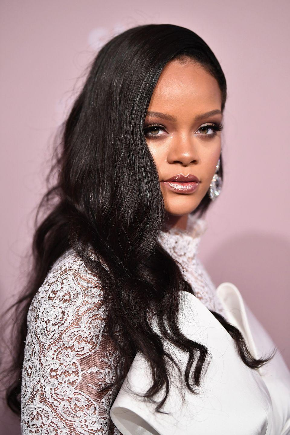 <p>Rihanna wears her hair down with slight waves at the end for an effortlessly cool look. </p>