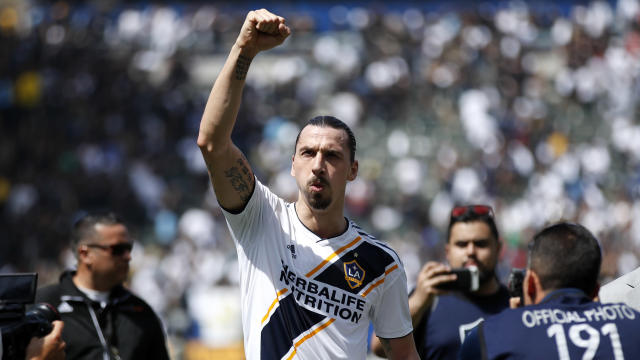 FILE - In this March 31, 2018 file photo Los Angeles Galaxy's Zlatan Ibrahimovic, of Sweden, acknowledges fans as he walks off the field after an MLS soccer match against the Los Angeles FC in Carson, Calif. Ibrahimovic and the LA Galaxy both announced Wednesday, Nov. 13, 2019 they are officially parting ways after two seasons. (AP Photo/Jae C. Hong, file)