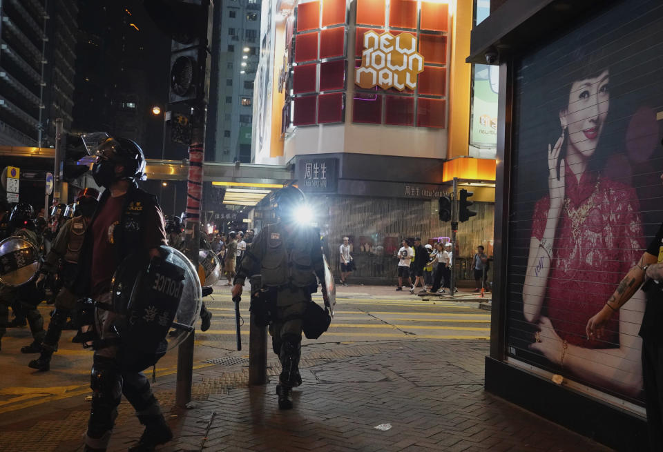 "Hong Kong police officers patrol Hong Kong on Sunday, Oct. 27, 2019. Hong Kong police fired tear gas Sunday to disperse a rally called over concerns about police conduct in monthslong pro-democracy demonstrations, with protesters cursing the officers and calling them ""gangster cops."" (AP Photo/Vincent Yu)"