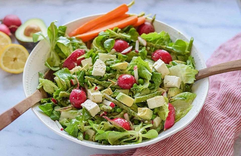 """<p>Asparagus — a <a href=""""https://www.thedailymeal.com/cook/spring-foods-in-season?referrer=yahoo&category=beauty_food&include_utm=1&utm_medium=referral&utm_source=yahoo&utm_campaign=feed"""" rel=""""nofollow noopener"""" target=""""_blank"""" data-ylk=""""slk:springtime treasure"""" class=""""link rapid-noclick-resp"""">springtime treasure</a> — can make appearances in many dishes, although it's often served as a side to steak and other hearty proteins. In this salad, it adds a level of freshness that complements the peas, avocado and feta cheese.</p> <p><a href=""""https://www.thedailymeal.com/best-recipes/spring-green-asparagus-salad?referrer=yahoo&category=beauty_food&include_utm=1&utm_medium=referral&utm_source=yahoo&utm_campaign=feed"""" rel=""""nofollow noopener"""" target=""""_blank"""" data-ylk=""""slk:For the Spring Green Salad With Asparagus recipe, click here."""" class=""""link rapid-noclick-resp"""">For the Spring Green Salad With Asparagus recipe, click here.</a></p>"""
