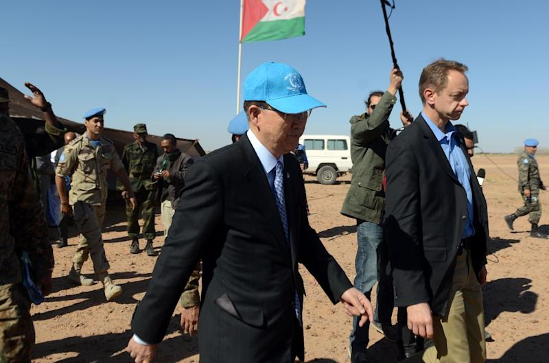United Nations chief Ban Ki-moon (C) leaves after a meeting with the Polisario Front's representative at the United Nations, on March 5, 2016, near a UN base in Bir-Lahlou, in the disputed territory of Western Sahara