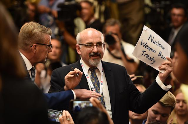 "<p>A man is escorted out of the press conference room for having a sign reading ""Nuclear weapon Ban Treaty"" ahead a joint press conference of the US and Russian presidents after a meeting at the Presidential Palace in Helsinki, on July 16, 2018. (Photo: Brendan Smialowski/AFP/Getty Images) </p>"