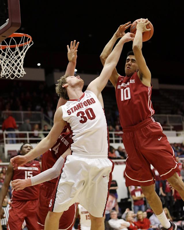 Stanford's Grant Verhoeven (30) battle for a rebound against Washington State's Dexter Kernich-Drew (10) during the second half of an NCAA college basketball game Wednesday, Jan. 15, 2014, in Stanford, Calif. (AP Photo/Marcio Jose Sanchez)