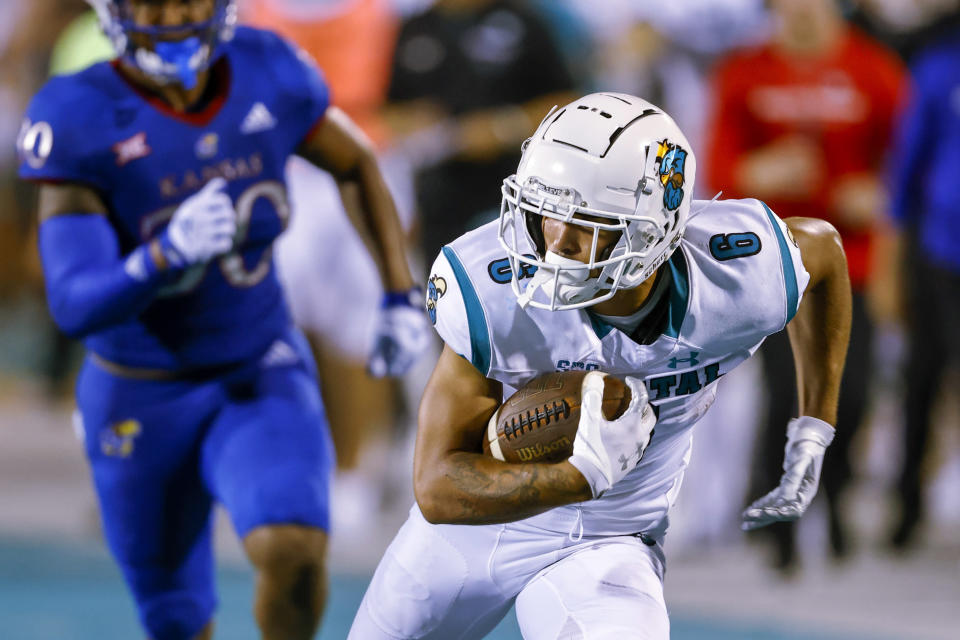 Coastal Carolina wide receiver Jaivon Heiligh, right, runs after a catch against Kansas during the second half of an NCAA college football game in Conway, S.C., Friday, Sept. 10, 2021. Coastal Carolina won 49-22. (AP Photo/Nell Redmond)