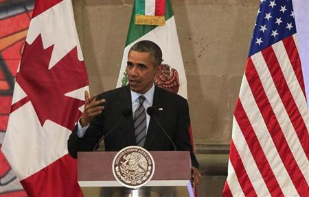 U.S. President Obama gives a speech during a news conference at the North American Leaders' Summit in Toluca