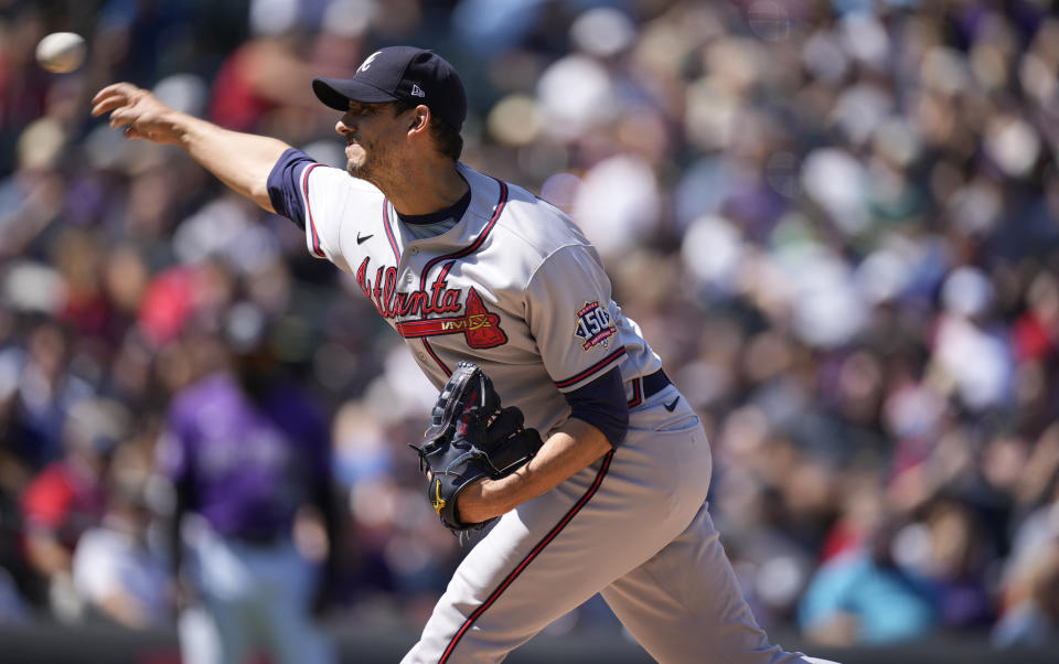 Atlanta Braves starting pitcher Charlie Morton works against the Colorado Rockies in the first inning of a baseball game Sunday, Sept. 5, 2021, in Denver. (AP Photo/David Zalubowski)
