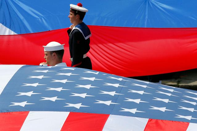 <p>French and U.S. soldiers display their national flags at the end the traditional Bastille Day military parade on the Champs Elysees in Paris, France, Friday, July 14, 2017. (Photo: Michel Euler/AP) </p>