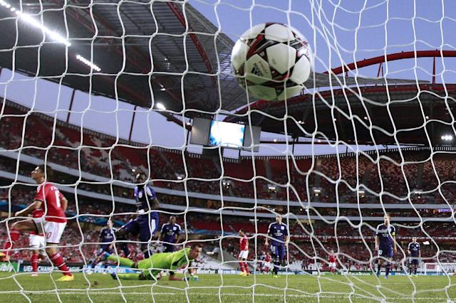 The ball hits the back of the net after Benfica's Filip Djuricic, left scores against Anderlecht during the Champions League group C soccer match between Benfica and Anderlecht Tuesday, Sept. 17, 2013, at Benfica's Luz stadium in Lisbon. (AP Photo/Armando Franca)