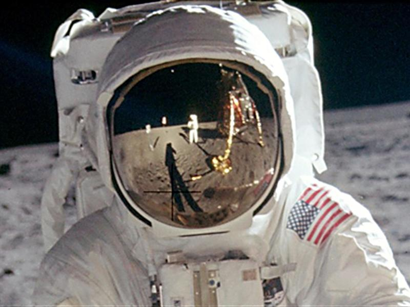 Reflection in helmet of Buzz Aldrin as he stands on lunar surface during Apollo 11 mission, photo