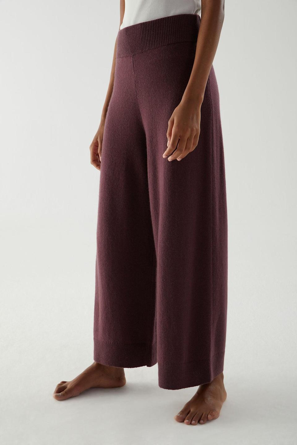 "<h2>COS Recycled Cashmere Wide-Leg Pant</h2><br>Leave it to the effortlessly understated COS to create a cashmere sweatpant that's too beautifully tailored to keep cooped up at home. These wine-colored wide-leg knit trousers are definitely appropriate for public consumption — and they're made from 70% recycled cashmere. (Even better, COS is a member of the <a href=""https://thegoodcashmerestandard.org/"" rel=""nofollow noopener"" target=""_blank"" data-ylk=""slk:Good Cashmere Standard"" class=""link rapid-noclick-resp"">Good Cashmere Standard</a>, a independent industry watchdog developed by the Aid by Trade Foundation that aims to improve the welfare of cashmere goats and the herders that raise them.)<br><br><strong>COS</strong> Recycled Cashmere Wide-Leg Pants, $, available at <a href=""https://go.skimresources.com/?id=30283X879131&url=https%3A%2F%2Fwww.cosstores.com%2Fen_usd%2Fwomen%2Fwomenswear%2Ftrousers%2Fproduct.recycled-cashmere-wide-leg-pants-red.0919262003.html"" rel=""nofollow noopener"" target=""_blank"" data-ylk=""slk:COS"" class=""link rapid-noclick-resp"">COS</a>"