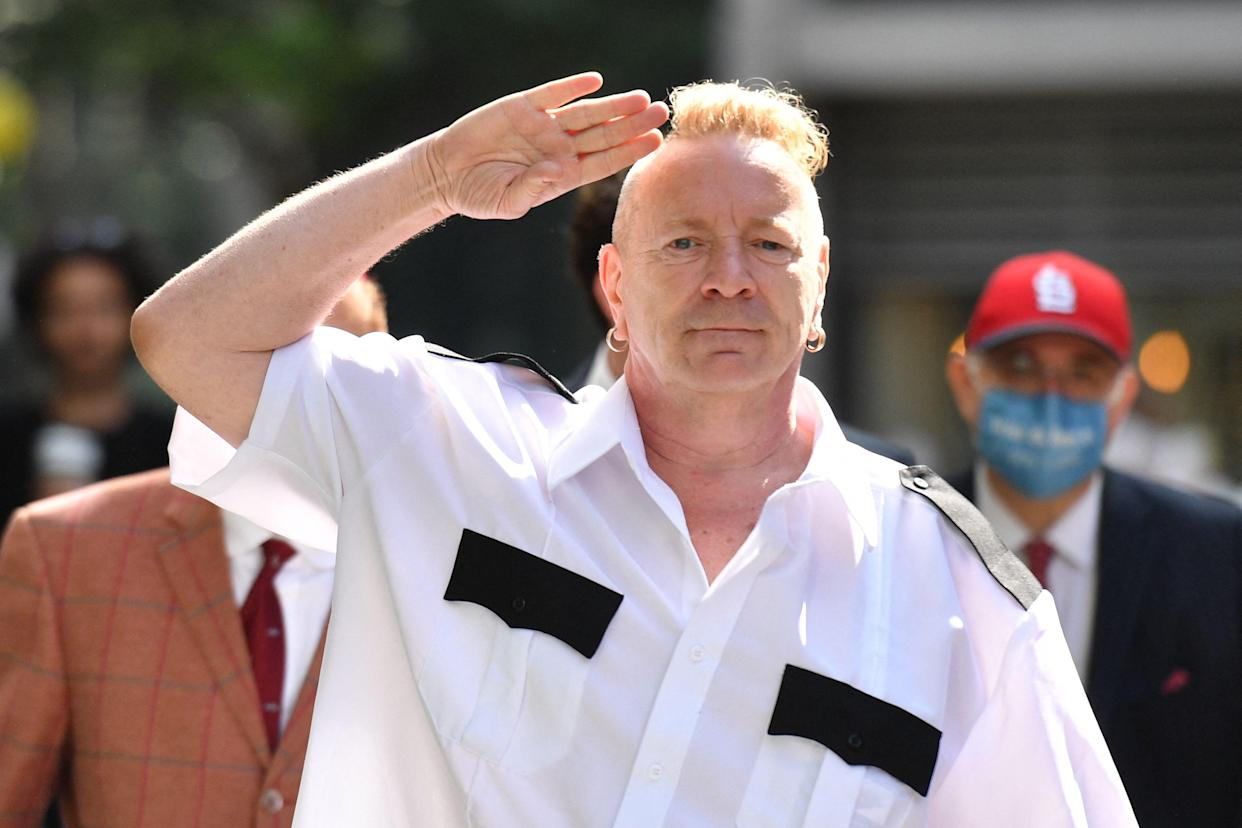 Sex Pistols frontman John Lydon, also known as Johnny Rotten arrives at the Rolls building in central London on July 22, 2021. - Lydon is in court to fight two former Sex Pistols band members over the use of their songs in an upcoming television series. (Photo by JUSTIN TALLIS / AFP) (Photo by JUSTIN TALLIS/AFP via Getty Images)