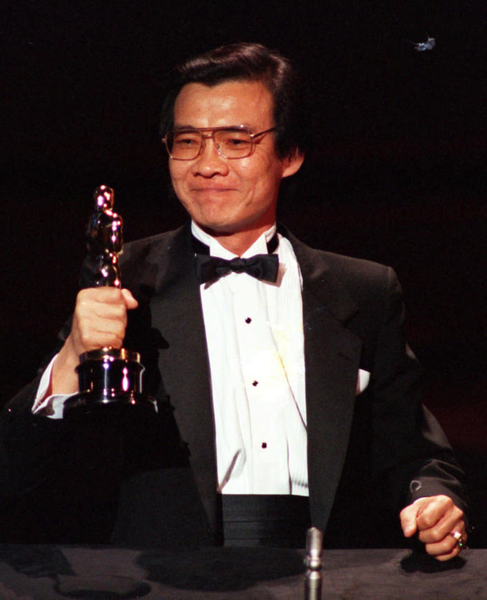 """FILE- Haing S. Ngor, accepts the award for best supporting actor Oscar for his role in """"The Killing Fields"""", at the 57th annual Academy Awards in Los Angeles on March 26, 1985. (AP Photo, File)"""
