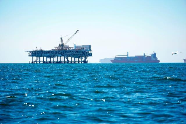 Dozens of cargo vessels are seen anchored offshore