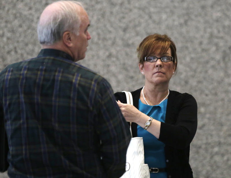 FILE - In this April 23, 2013 file photo, Theresa Neubauer, the former water supervisor in Crestwood, Ill., enters the federal court in Chicago. On Monday, April 29, 2013, Neubauer was convicted of lying for decades about drawing water for residents from a well the village knew was tainted by a cancer-causing chemical.  Neubauer, 55, is the only Crestwood official to go to trial in a scandal that shocked the region for the apparent callousness displayed by village officials. (AP Photo/M. Spencer Green, File)