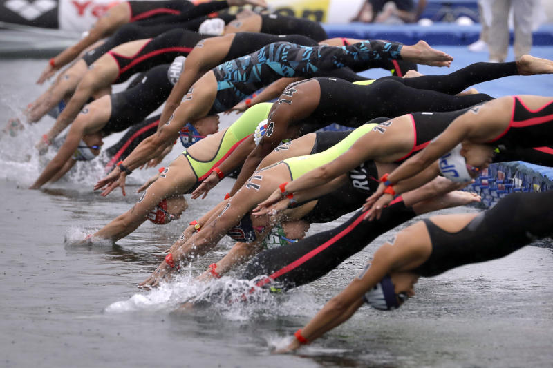 Swimmers leap into the water at the start of the 5km mixed relay open water swim at the World Swimming Championships in Yeosu, South Korea, Thursday, July 18, 2019. (AP Photo/Mark Schiefelbein)