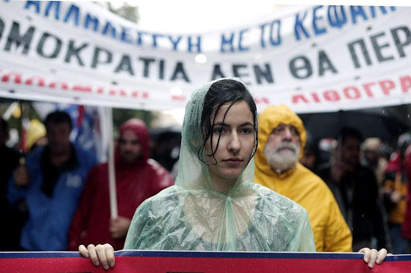 Members of pro-communist union PAME take part in an protest during a general strike in Athens, on Wednesday, Nov. 6, 2013. Services across Greece shut down Wednesday as unions held a 24-hour general strike to protest further austerity cuts in the cash-strapped country. (AP Photo/Petros Giannakouris)