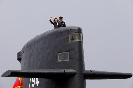 FILE PHOTO: Taiwan President Tsai Ing-wen waves as she boards Hai Lung-class submarine (SS-794) during her visit to a navy base in Kaohsiung, Taiwan March 21, 2017.  REUTERS/Tyrone Siu/File Photo