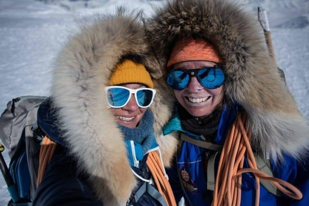 Mountaineers Eva Capozzola, left, and Pascale Marceau enjoying a celebratory moment atop Mount Lucania, Canada's third-highest peak. The pair have just returned from their 21-day expedition. (Eva Capozzola - image credit)