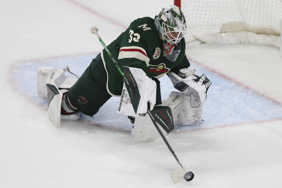 Minnesota Wild goalie Cam Talbot hits the puck away from the net during the third period in Game 3 of a first-round NHL hockey playoff series against Vegas Golden Knights, Thursday, May 20, 2021, in St. Paul, Minn. The Golden Knights won 5-2. (AP Photo/Stacy Bengs)