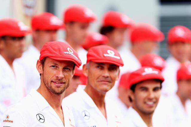 MONZA, ITALY - SEPTEMBER 08: (L-R) Jenson Button, Martin Whitmarsh and Sergio Perez and McLaren team mates pose for a team photograph as they celebrate their 50th year in Formula One during the Italian Formula One Grand Prix at Autodromo di Monza on September 8, 2013 in Monza, Italy. (Photo by Mark Thompson/Getty Images)