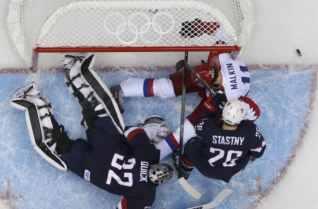 Team USA's goalie Jonathan Quick (32) makes a save on Russia's Yevgeni Malkin (R) as Team USA's Paul Stastny looks on during the first period of their men's preliminary round ice hockey game at the Sochi 2014 Winter Olympic Games February 15, 2014. REUTERS/Jim Young (RUSSIA - Tags: SPORT ICE HOCKEY OLYMPICS)