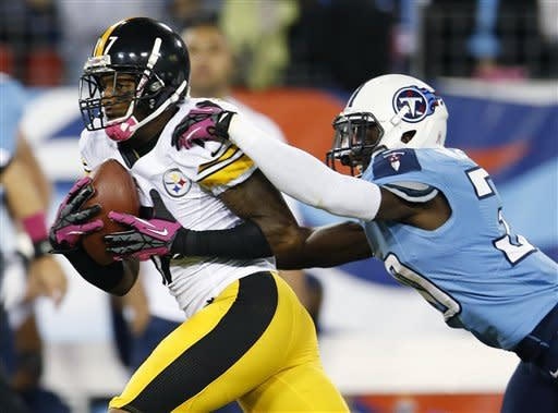 Pittsburgh Steelers wide receiver Mike Wallace, left, hauls in a catch for a touchdown as Tennessee Titans cornerback Jason McCourty defends during the first half of an NFL football game Thursday, Oct. 11, 2012, in Nashville, Tenn. (AP Photo/Joe Howell)