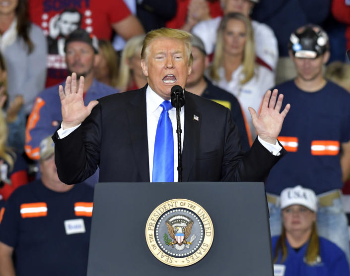 President Donald Trump reacts as he speaks to a crowd at Eastern Kentucky University, Saturday, Oct. 13, 2018, in Richmond, Ky. (AP Photo/Timothy D. Easley)