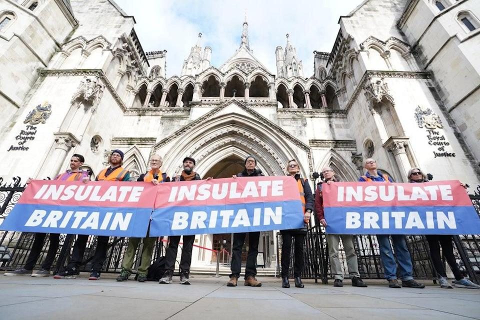 Members of Insulate Britain outside the Royal Courts of Justice in London (Ian West/PA) (PA Wire)