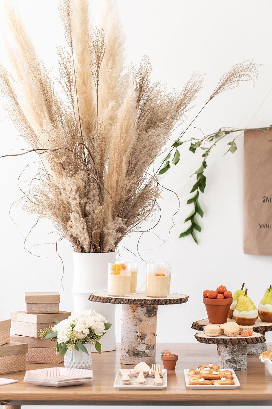 """<p>Dried reeds and grasses make for a totally unexpected Thanksgiving centerpiece. Evoking the earthiness of the fall season, their muted tones and subdued color palette is sure to elicit more than a few <em>ooh</em>s and <em>aah</em>s from your guests.</p><p><strong>Get the tutorial at <a href=""""https://sugarandcharm.com/diy-thanksgiving-dessert-table"""" rel=""""nofollow noopener"""" target=""""_blank"""" data-ylk=""""slk:Sugar and Charm"""" class=""""link rapid-noclick-resp"""">Sugar and Charm</a>.</strong></p><p><a class=""""link rapid-noclick-resp"""" href=""""https://www.amazon.com/Dongliflower-Natural-Pampas-Plumes-Wedding/dp/B07P8PX592?tag=syn-yahoo-20&ascsubtag=%5Bartid%7C10050.g.2130%5Bsrc%7Cyahoo-us"""" rel=""""nofollow noopener"""" target=""""_blank"""" data-ylk=""""slk:SHOP DRIED REEDS"""">SHOP DRIED REEDS</a></p>"""