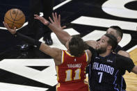Atlanta Hawks guard Trae Young (11) is fouled by Orlando Magic guard Michael Carter-Williams (7) while going for a shot near the end of the second half of an NBA basketball game, Wednesday, March 3, 2021, in Orlando, Fla. (AP Photo/Phelan M. Ebenhack)