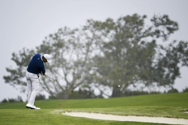 Tiger Woods hits his second shot on the fourth hole of the South Course at Torrey Pines Golf Course during the third round of the Farmers Insurance golf tournament Saturday Jan. 25, 2020, in San Diego. (AP Photo/Denis Poroy)