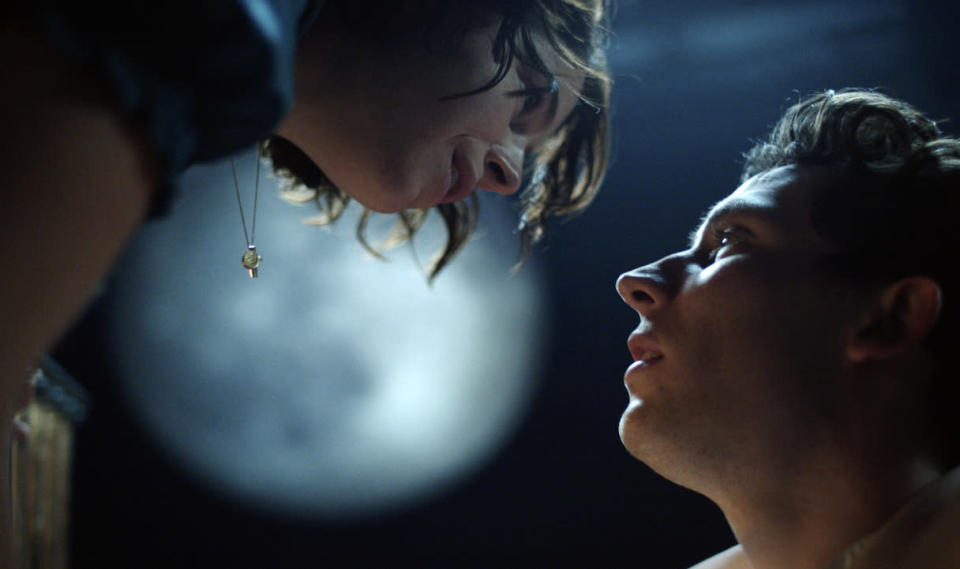 """This image released by PBS shows Jessie Buckley, left, and Josh O'Connor from Great Performances' """"Romeo & Juliet,"""" premiering Friday, April 23. ( National Theatre/PBS via AP)"""