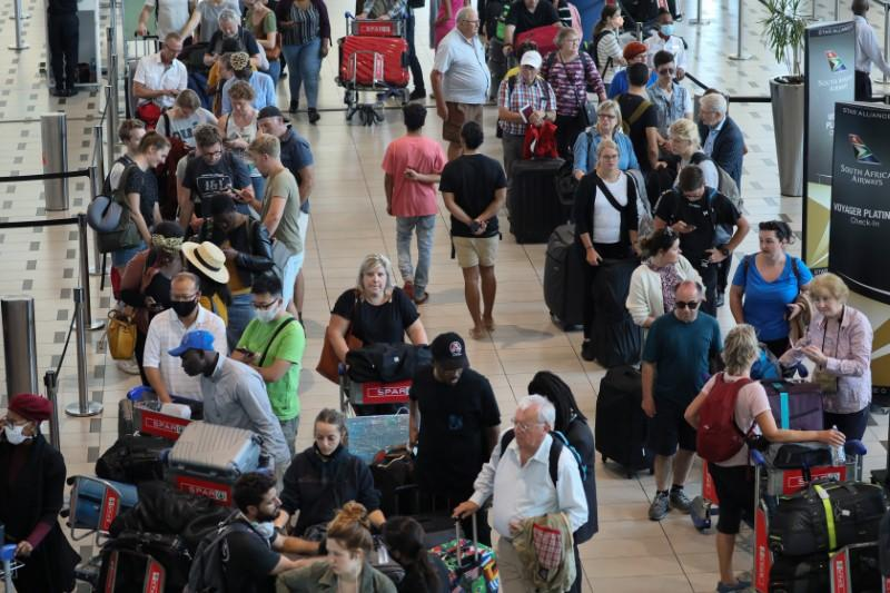 Passengers queue to check in for flights at Cape Town International Airport
