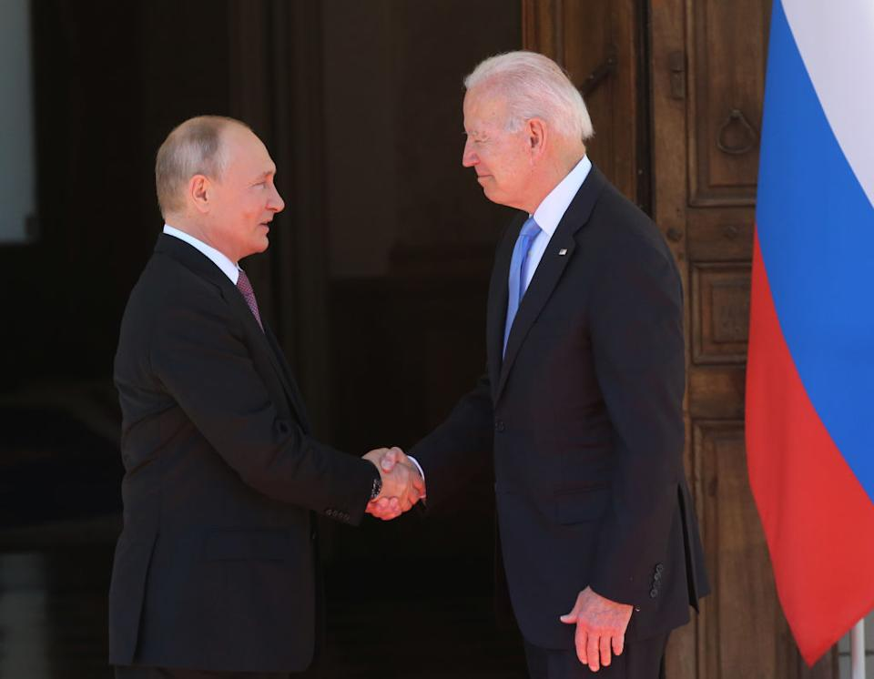 GENEVA, SWITZERLAND - JUNE,16 (RUSSIA OUT): Russian President Vladimir Putin (L) greets President of USA Joe Biden (R) during the US - Russia Summit 2021 at the La Grange Villa near the Geneva Lake, on June,16,2021, in Geneva, Switzerland. U.S.President Joe Biden is meeting Russian President Putin in Geneva for the first time as presidents, on Wednesday. (Photo by Mikhail Svetlov/Getty Images)