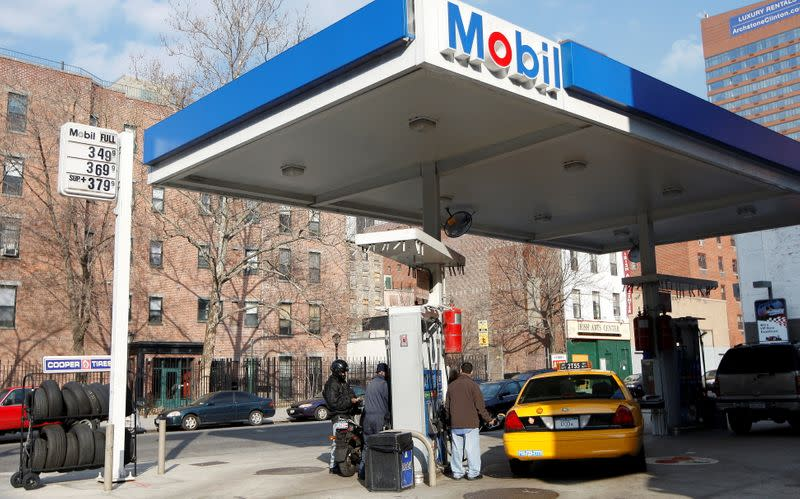 FILE PHOTO: A taxi is refuelled at a gas station on Manhattan's West Side in New York