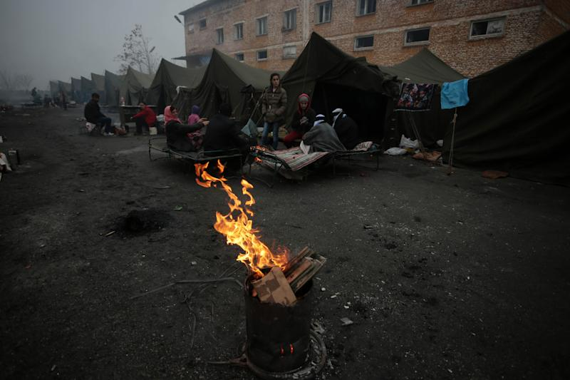A view of refugees warming themselves with open fires in front of their unheated tents in a refugee camp in the town of Harmanli, Bulgaria, Thursday, Nov. 21, 2013. Thousands of Syrian and other refugees from the Middle East, Asia and Africa, who find enough courage to make a dangerous journey from their war-ravaged states, often end up in the crammed settlements in the Balkans, including Bulgaria, Greece or Serbia, after being caught on the borders of wealthy Western European nations for attempting to cross illegally. (AP Photo/Valentina Petrova)