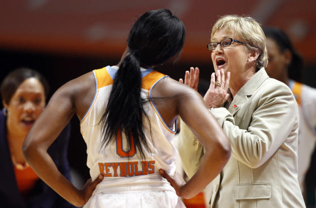 Tennessee head coach Holly Warlick, right, talks to guard Jordan Reynolds (0) in the first half of an NCAA college basketball game against South Carolina, Sunday, March 2, 2014, in Knoxville, Tenn. (AP Photo/Wade Payne)